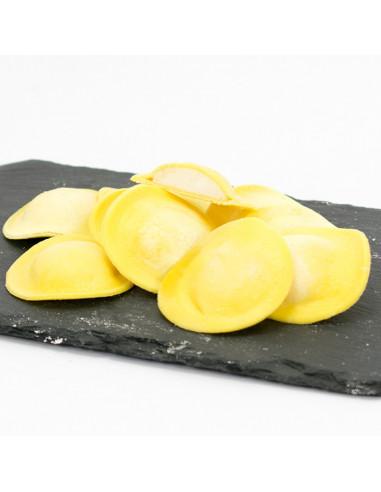 Raviolis de formatge de cabra i ceba caramel·litzada